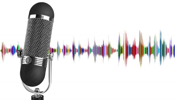 Hansaton: Links ein Mikrofon, im Hintergrund ein farbiges Frequenzmuster