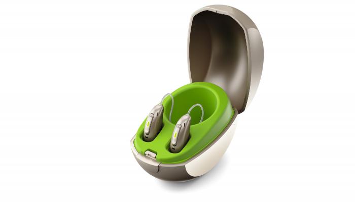 Phonak: Mini-Ladestation für Phonak-Paradise-Hörgeräte mit eingesteckten Hörgeräten